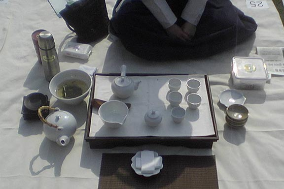Laying out the Tea Ware